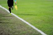 Assistant referee in action on a soccer field — Stock Photo