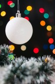 New Year's and Christmas balls with cones on the background bokeh — Stock Photo