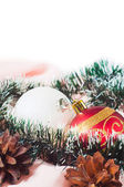 New Year's and Christmas balls with cones on white background — Stock Photo