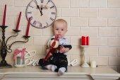 Baby on the mantelpiece — Stock Photo