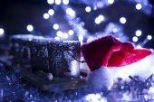 Advent, four candles decorated and Santa Claus hat — Stock Photo