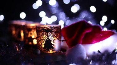 Advent, four candles decorated and Santa Claus hat — Vídeo de stock