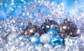 Christmas balls in tinsel — Stock Photo