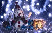Snowman brought Christmas balls — Stock Photo