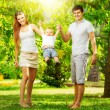 Young family having fun in  summer park — Stock Photo #61542479