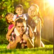 Family having fun outdoors in summer. — Stock Photo #61543889