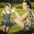 Baby girl is doing her first steps with mothers help — Stock Photo #61544125