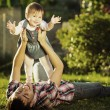 Father and baby daughter having fun in sunny garden. — Stock Photo #61544221