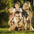 Family having fun outdoors in summer. — Stock Photo #61544265