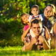 Family having fun outdoors in summer. — Stock Photo #61544545