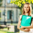 Student woman with  folder and copy-book — Stock Photo #61545785