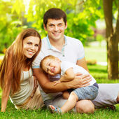 Young family having fun in  summer park — Foto Stock