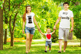 Young family having fun in  summer park — Foto de Stock
