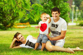 Young family having fun in  summer park — Stock Photo