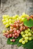 Ripe grapes on a wooden table — Stock Photo