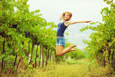 Woman jumping in  vineyard — Stock Photo