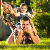 Happy young family having fun outdoors — Stockfoto