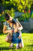 Mother taking care of her daughter — Stock Photo