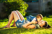 Mother and daughter having fun in  sunny garden — Stock Photo