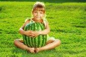 Little girl  hugging huge watermelon — Stock Photo