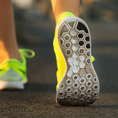 Runner woman feet — Stock Photo