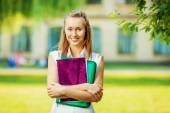 Student woman with folder and copy-book — Stock Photo