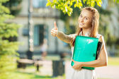 Student woman showing thumb up — Stock Photo