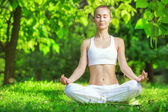 Woman meditating in lotus position. — Stock Photo