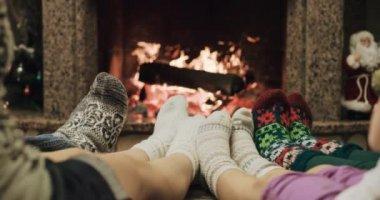 Feet warming by cozy fire — Stock Video