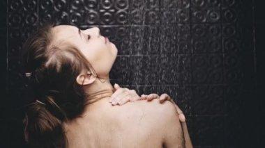 Woman taking shower — Stock Video