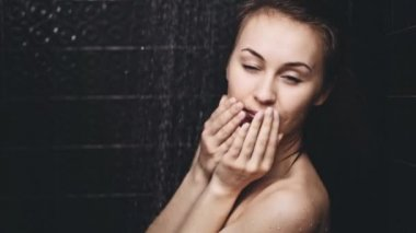 Woman smiling in the shower — Stock Video