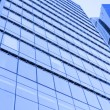 Perspective wide angle view to blue glass building skyscraper — Stock Photo #78000354