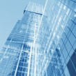 Perspective wide angle view to blue glass building skyscraper — Stock Photo #78000456
