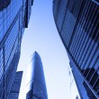 Perspective wide angle view to blue glass building skyscrapers — Stock Photo #78011274