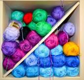 Shelf with knitting yarn balls — Stock Photo