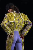 Woman bullfighter posing suit on his back with light purple and gold with sword — Stock Photo