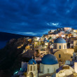 Churches of Oia village at dusk with dramatic sky, Santorini — Stock Photo #54168209