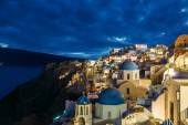 Churches of Oia village at dusk with dramatic sky, Santorini — Stock Photo