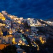 Churches of Oia village at dusk at Santorini — Stock Photo #65044763