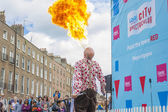 Dublin, Ireland - July 13: Fire-eater in The Laya Healthcate Cit — Stock Photo
