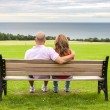 Adult couple on the bench — Stock Photo #56905003