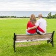 Adult couple on the bench — Stock Photo #56907953