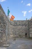 Irish Flag in Kilmainham Gaol in Dublin — Stock Photo