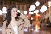 Woman talking by phone — Stock Photo