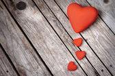 Hearts on wood background — Stock Photo
