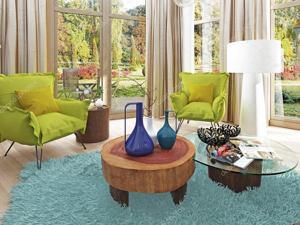 Moderna vardagsrum med en sittgrupp med två stolar ...