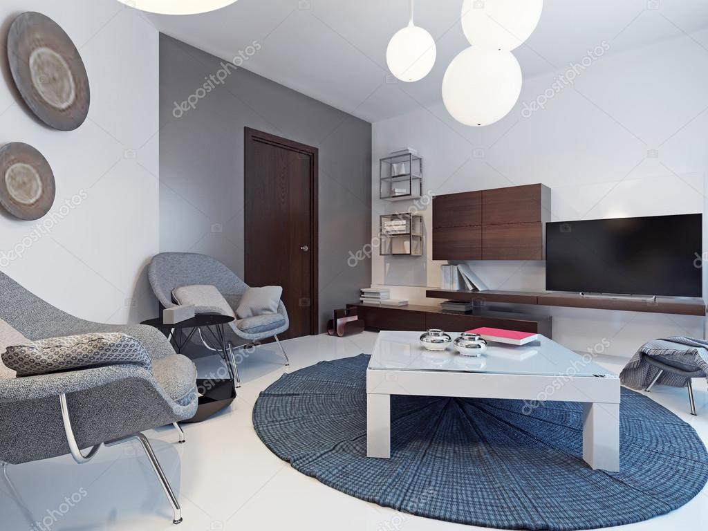 Wit woonkamer met tvs met drie schappen en boekenkasten ...