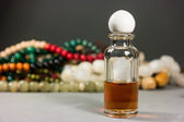 Glass bottles and beads — Stock Photo