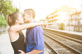 Couple hug each other at the train station — Stock Photo