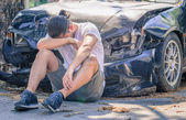 Desperate man after car crash — Stock Photo